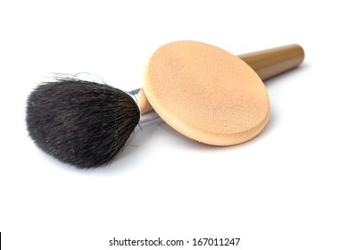 brush and sponge for make up on white background