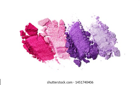 Brush stroke of shiny crushed bright purple and pink eye shadow as sample of cosmetic product isolated on white background