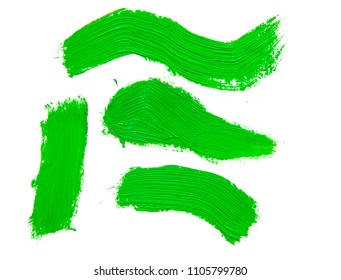 Brush Strokes of green paint isolated on white background.