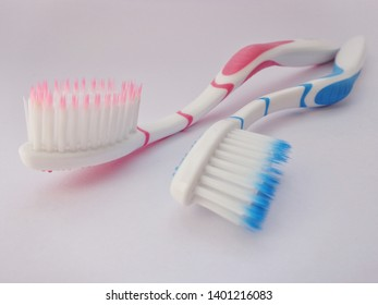Brush teeth with a white background.