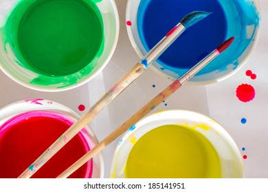 Brush and water-color paint buckets