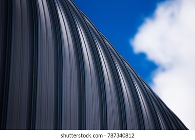 Brushed curved metal roof.