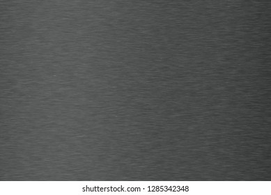 Brushed  dark metal texture. Polished metal texture background with light reflection.