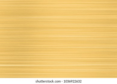 Brushed gold  metal texture. Polished metal texture background with light reflection.