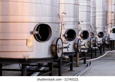 Brushed steel tanks for winemaking waiting for the new grape harvest in Napa Valley, Sonoma County, California
