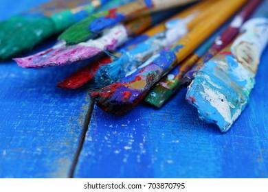 brushes on a blue wooden background. Vintage