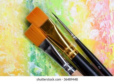 brushes on painted background.