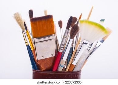 Brushes on the tin can isolated on a white background