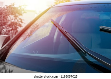 Brushes on the windshield with copy space. The concept of cleaning agent, polishing, nanocoatings