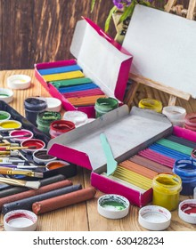 Brushes, paints and other art objects for drawing lessons in school
