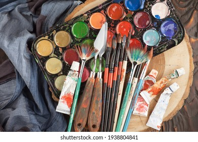 Brushes and paints for painting on an old background.