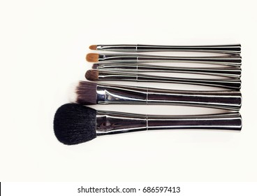 Brushes for professional make-up with fashionable silver handles.