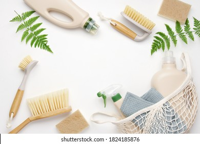 Brushes, sponges and rag on white background.  Eco-friendly cleaning products. Frame background