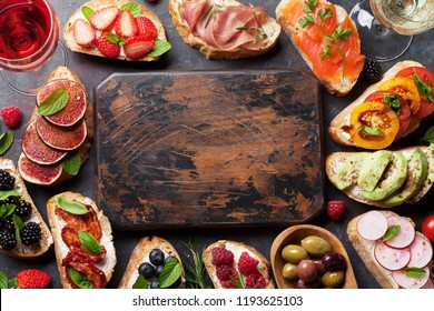 Brushetta or traditional spanish tapas. Appetizers italian antipasti snacks set with wine. Top view and flat lay with space for your text