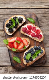 Brushetta or traditional spanish tapas with various berries. Appetizers italian antipasti snacks set. Top view and flat lay