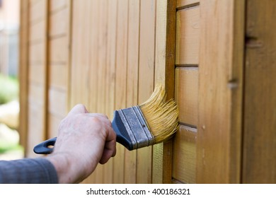 Brushing wood with brush with yellow color