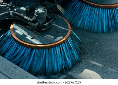 Brushs of street cleaning machine on street