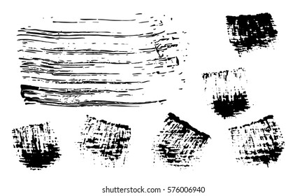 brushstrokes collection. a set of black traced strokes made by paint brush on a wooden surface