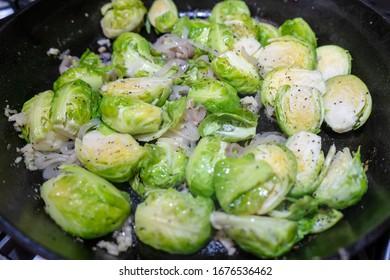 Brussel Sprouts sautéing inn cast iron skillet