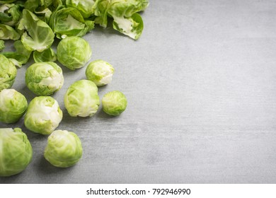 Brussel sprouts and peels on a stone background.