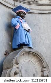 BRUSSELS - AUG 22: Manneken Pis sculpture dressed in a graduate costume. August 22, 2015 in Brussels, Belgium