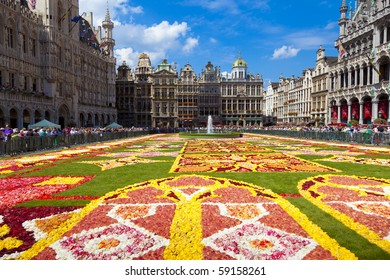 BRUSSELS - AUGUST 14: As every two years thousands of visitors come to see the floral carpet on the Grand Place square on August 14, 2010 in Brussels. Almost 800,000 begonias were used this year.
