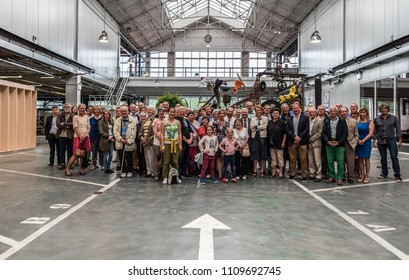 Brussels, Belgium - 05 23 2018: Group of visitors in the old Citroen garage shortly after the opening of Kanal Centre Pompidou