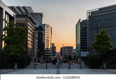 Brussels, Belgium -  06 26 2018: Business people at the European headquarters in Brussels downtown at dusk