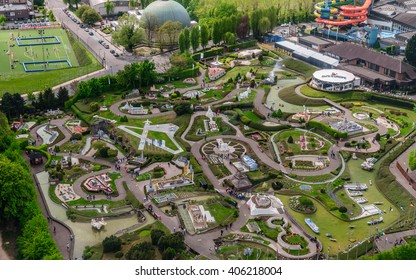 "BRUSSELS, BELGIUM - 07 MAY 2015: Panoramic view from the observation deck on the top level of the Atomium - the green trees, modern and historic buildings,  and miniature Park ""Mini Europe"","