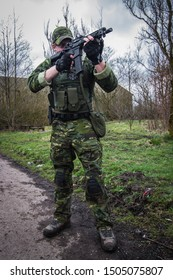 Brussels, Belgium, 10/07/2019 portrait of man playing airlift dressing up as real military soldiers, with replica rifles and pistols impersonating special forces and using tactics with squad gameplay