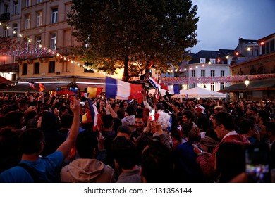 Brussels, Belgium. 10th July 2018. French supporters celebrate after their team's victory during the Russia 2018 World Cup semi-final football match between France and Belgium.