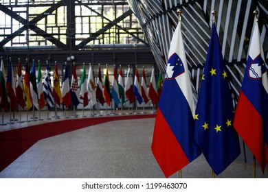 Brussels, Belgium. 10th October 2018. European and Slovenian flags stand in European Council building.