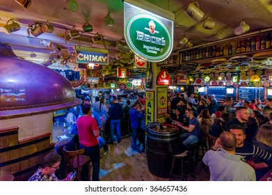 BRUSSELS, BELGIUM - 11 AUGUST, 2015: Famous Delirium Bar inside overview crowded room of people enjoying their beers