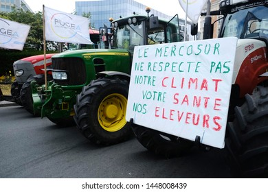 Brussels, Belgium. 11th July 2019. Tractors are seen outside of EU Commission Headquarters as farmers  take part in a protest against the EU's Mercosur trade deal.