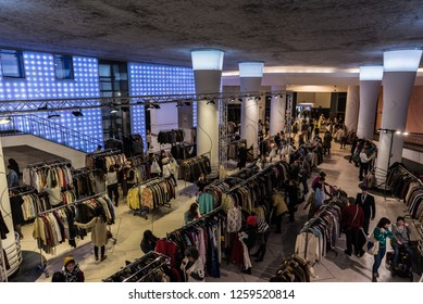 Brussels, Belgium - 12 20 2017: Vintage mode fair with people buying second hand clothes at the Horta Gallery