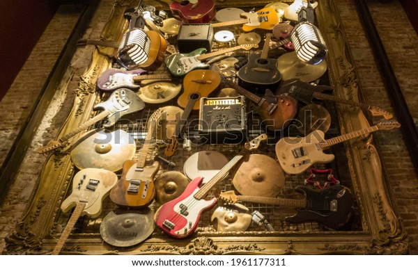 Brussels, belgium -  12 28 2019 varity of guitars hanging on the wall in hard Rock cafe