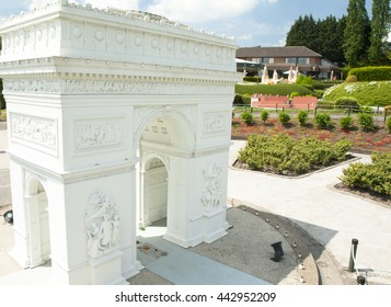BRUSSELS, BELGIUM - 13 MAY 2016: Miniatures at the park Mini-Europe - reproductions of monuments in the European Union at a scale of 1:25. Triumphal Arch, Paris, France.