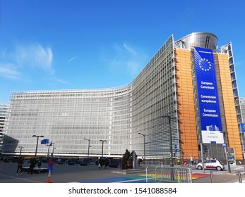 Brussels, Belgium - 13 October 2019: The building of the European Commission (EC) with the EU flag on a sunny day in Brussels. The EC is the EU executive body responsible for enforcing legislation.