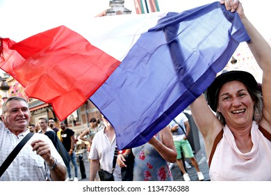 Brussels, Belgium. 14th July 2018. French supporters celebrate after the final of the Russia 2018 World Cup Football Match between France and Croatia