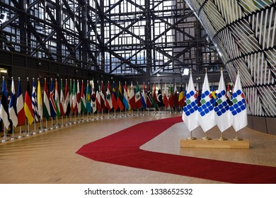 Brussels, Belgium. 14th March 2019. Flags of participants at an international conference on the future of Syria and the region.