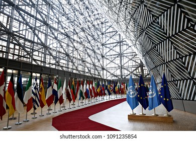 Brussels, Belgium, 15 May 2018.Flags of UN and EU stand in European council Building.