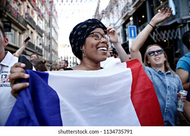 Brussels, Belgium. 15th July 2018. French supporters celebrate after the final of the Russia 2018 World Cup Football Match between France and Croatia