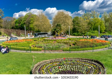 BRUSSELS, BELGIUM - 17 April 2017: Tourist bus gathers people at the garden in front of the Atomium, Brussels, Belgium, Europe