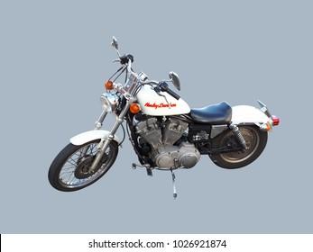 Brussels, Belgium - 17 February 2018: White Harley Davidson motorcycle isolated on grey-blue background.