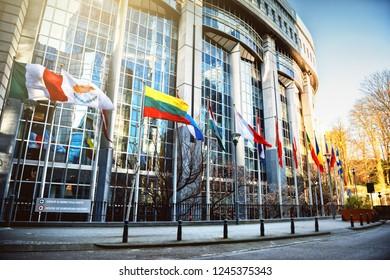 Brussels/ Belgium- 19 April 2018: Waving flags in front of European Parliament building