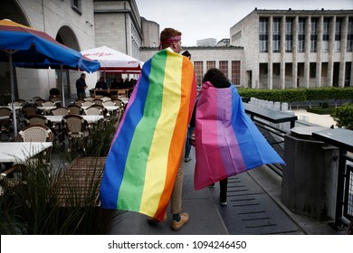 Brussels, Belgium. 19th May, 2018. People wearing rainbow flag during  the annual Belgian LGBT Pride Parade.