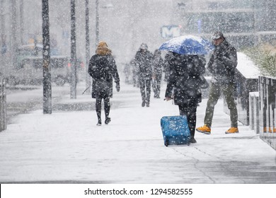 Brussels, Belgium. 22nd January 2019.People walk through a snow-covered streets during a heavy snowfall.