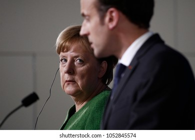 Brussels, Belgium. 23rd March 2018. Germany's Chancellor Angela Merkel and French president Emmanuel Macron gives a press conference with on the second day of a summit of European Union (EU) leaders.