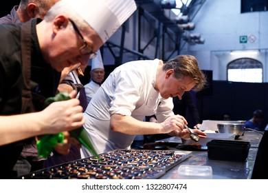 Brussels, Belgium. 24th February 2019. Famous Belgian chocolatier Pierre Marcolini prepares chocolate dessert  in Salon du Chocolat.