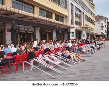 Brussels, Belgium - 25 August 2017: Tables and deck chairs outside in Flagey district
